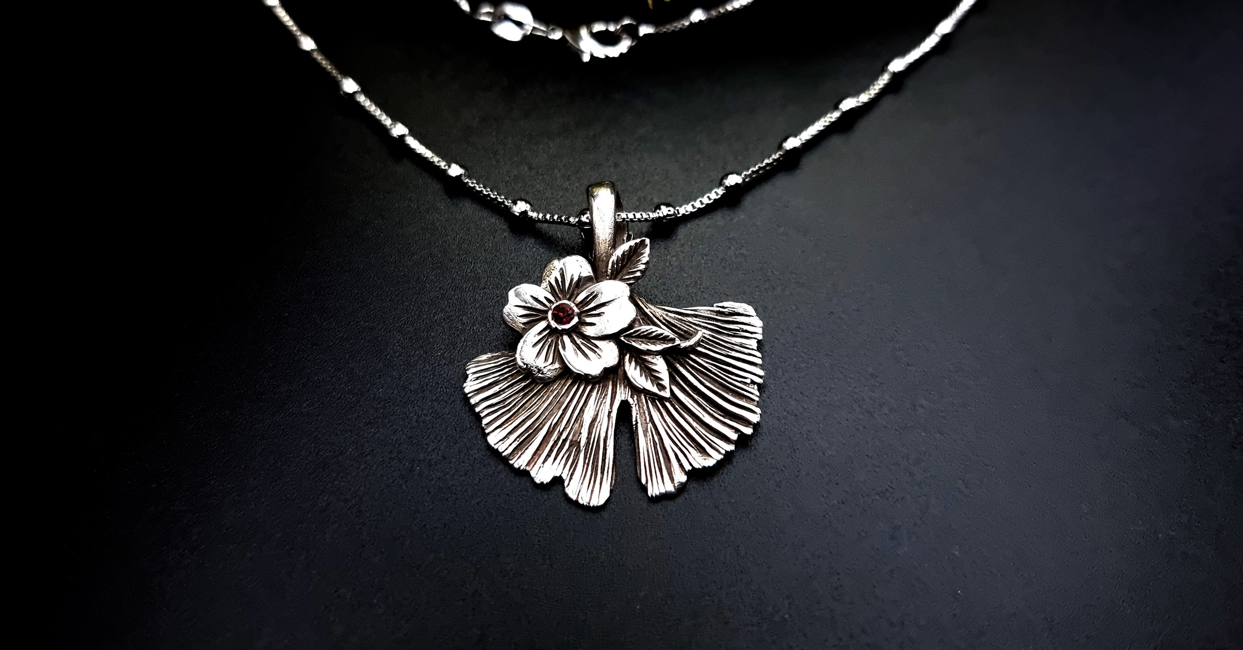 Nature-inspired silver ginkgo leaf pendant